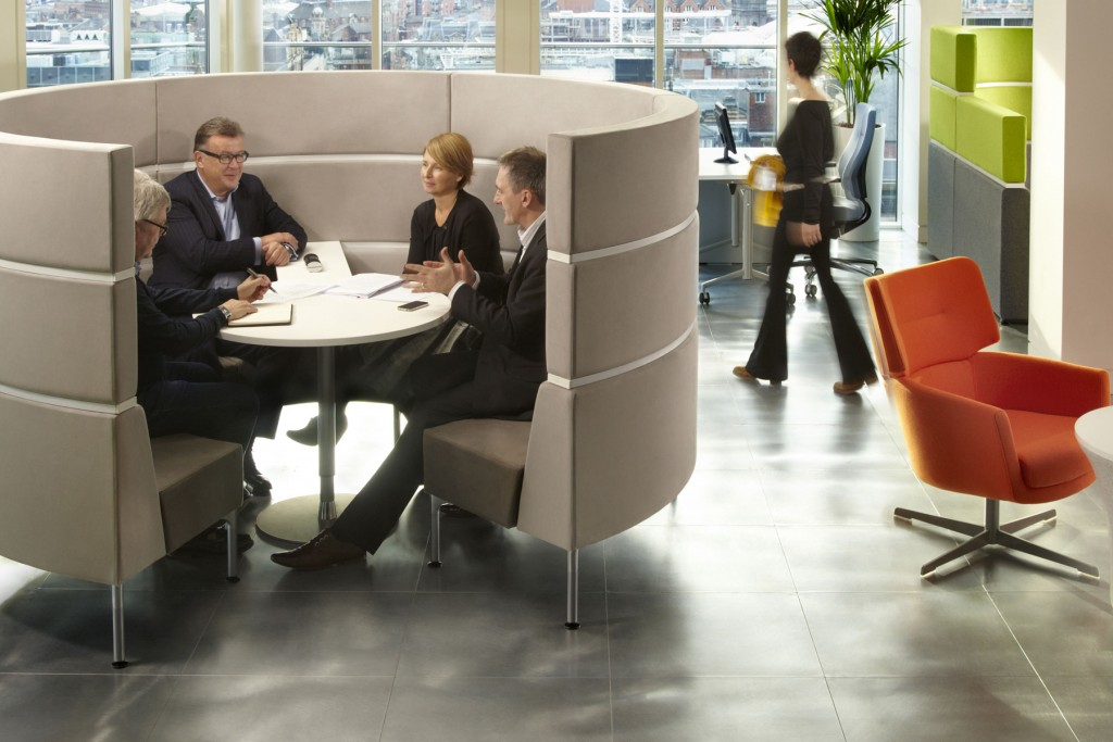 Acoustic furniture allows small groups to brainstorm effectively in a gym-style layout in their office.