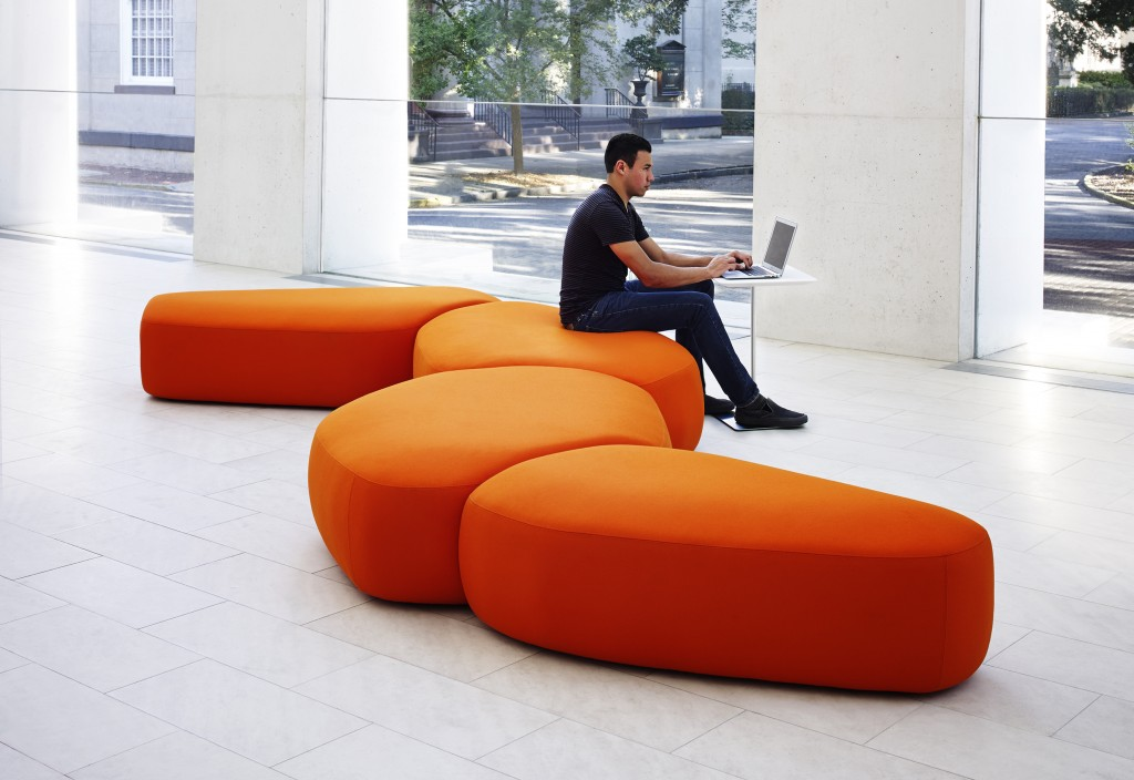Citrus orange collaborative furniture such as this seating, draws attention and engagement