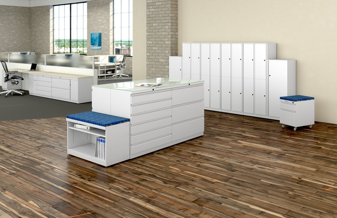 Multiple white office storage solutions for a modern office with lots of space.