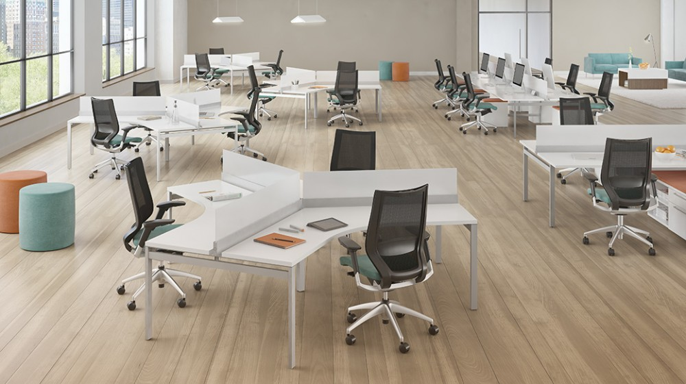 Modern office with screen protectors and ergonomic chairs.