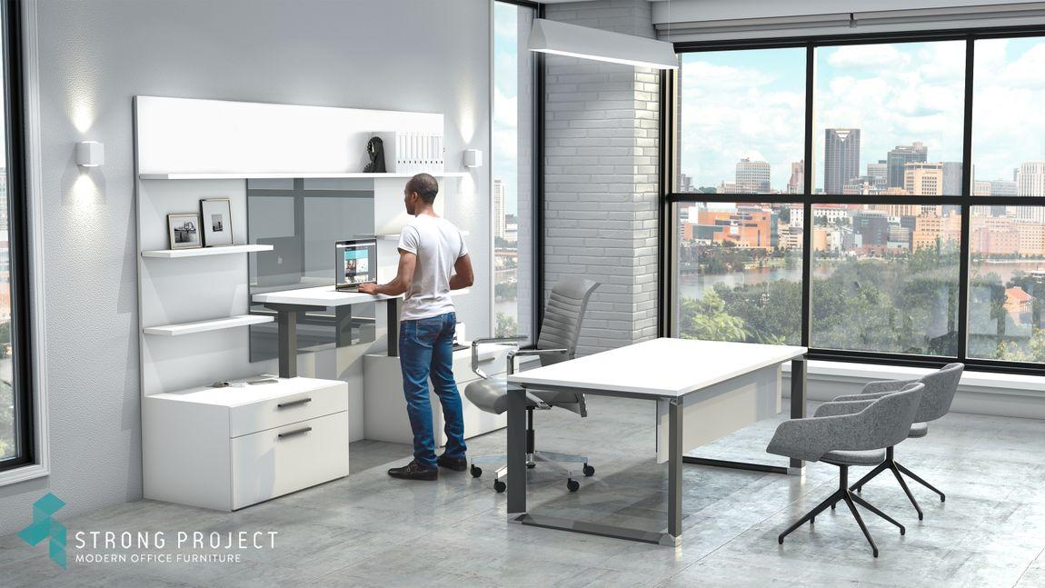 man at executive minimalist adjustable height desk