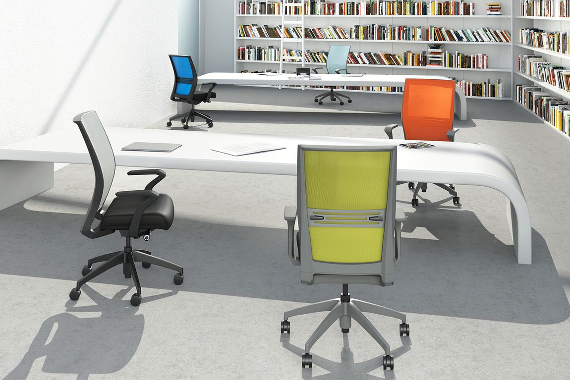Multi colored fabric chairs in an office library