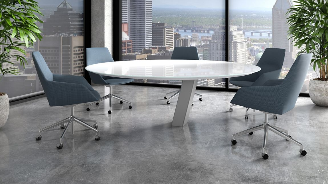 A chic white circular conference table in a highrise.