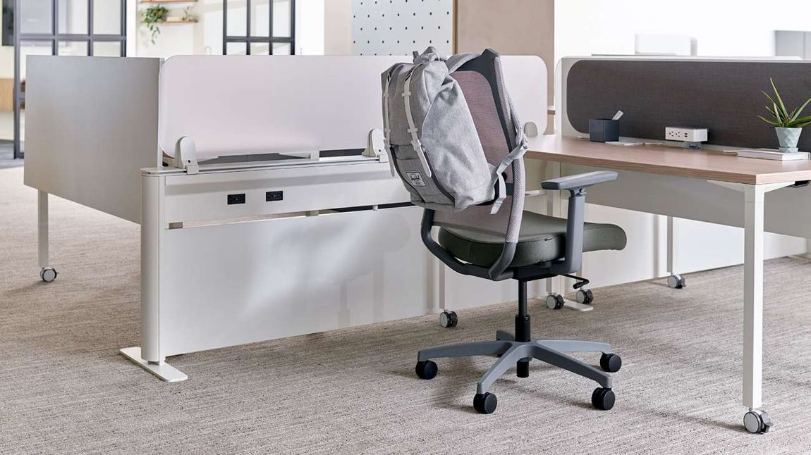 Chair at desktop for one in hybrid office.