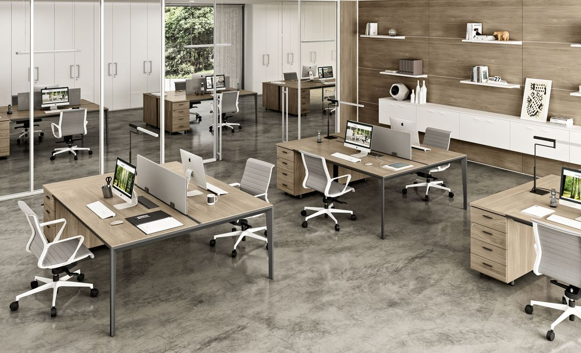 Collaborative office space with laptops and desks