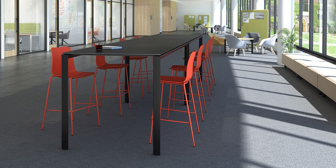 large conference table with chairs making use of open office space
