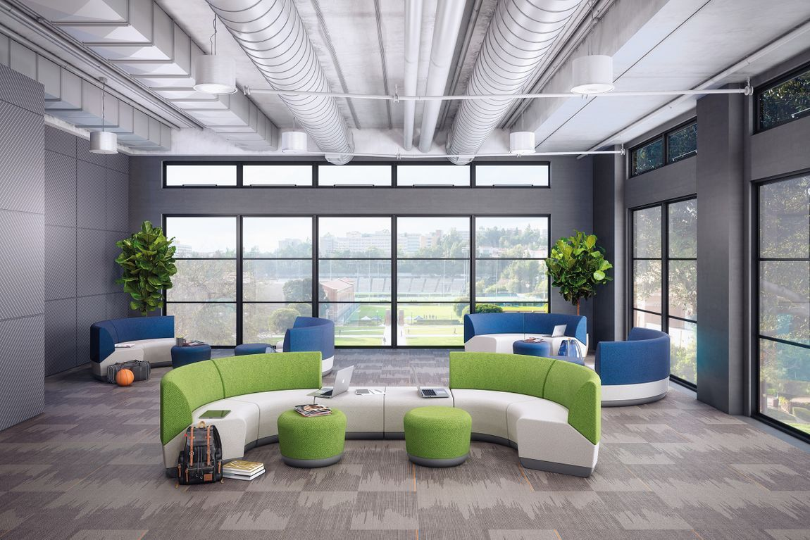 Bright and colorful office space with collaboration furniture and occasional tables.
