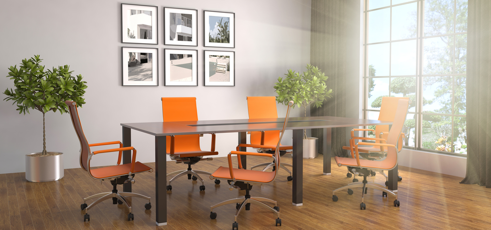 Office conference table with orange chairs