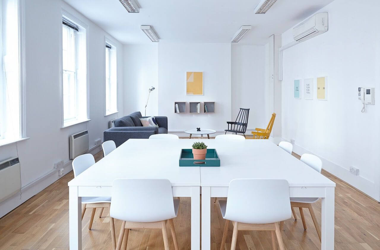 Modern office design with conference table and natural light