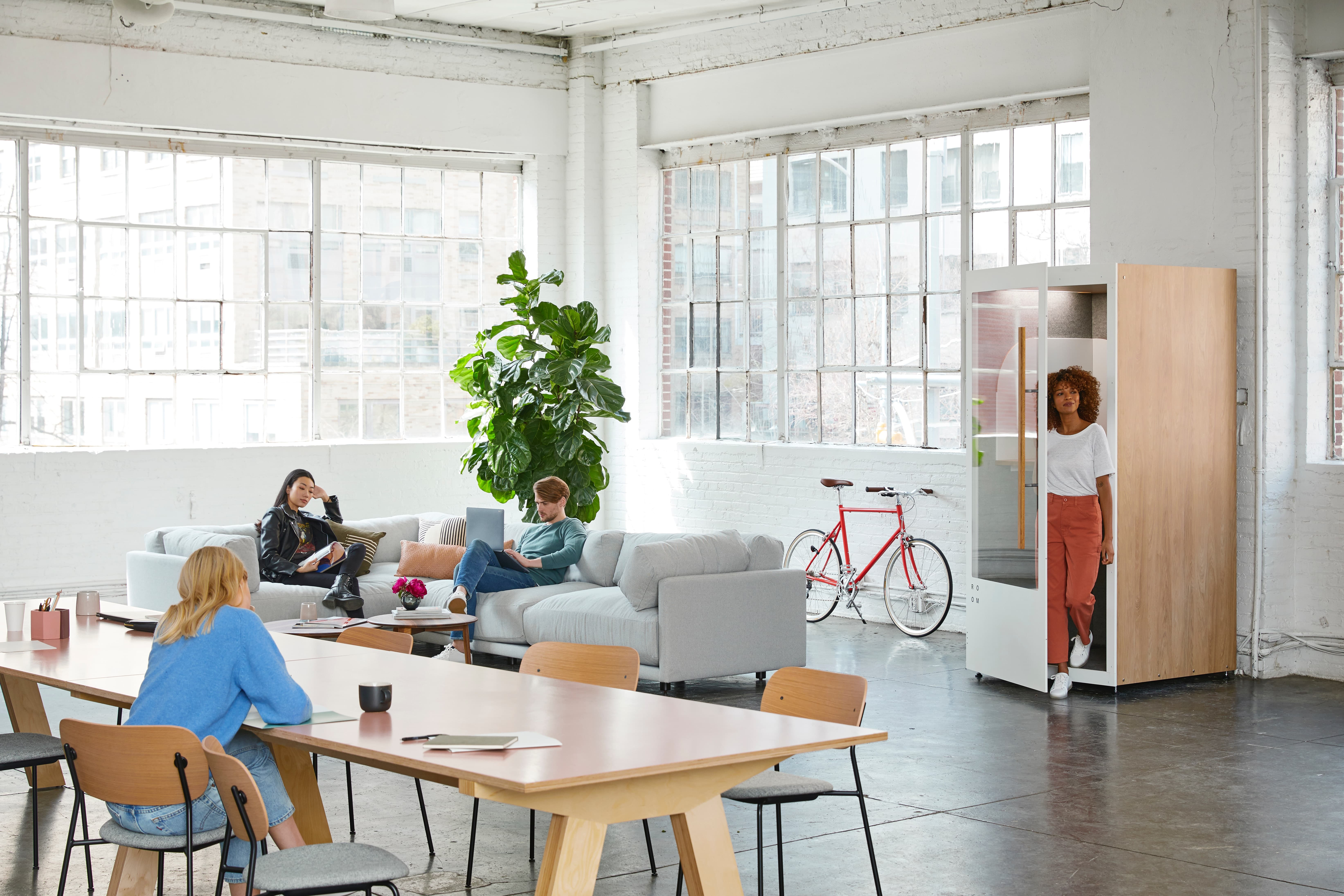 Big office interior with natural light and pod