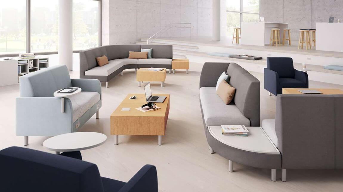 Modern office with sustainable furniture and neutral colors.