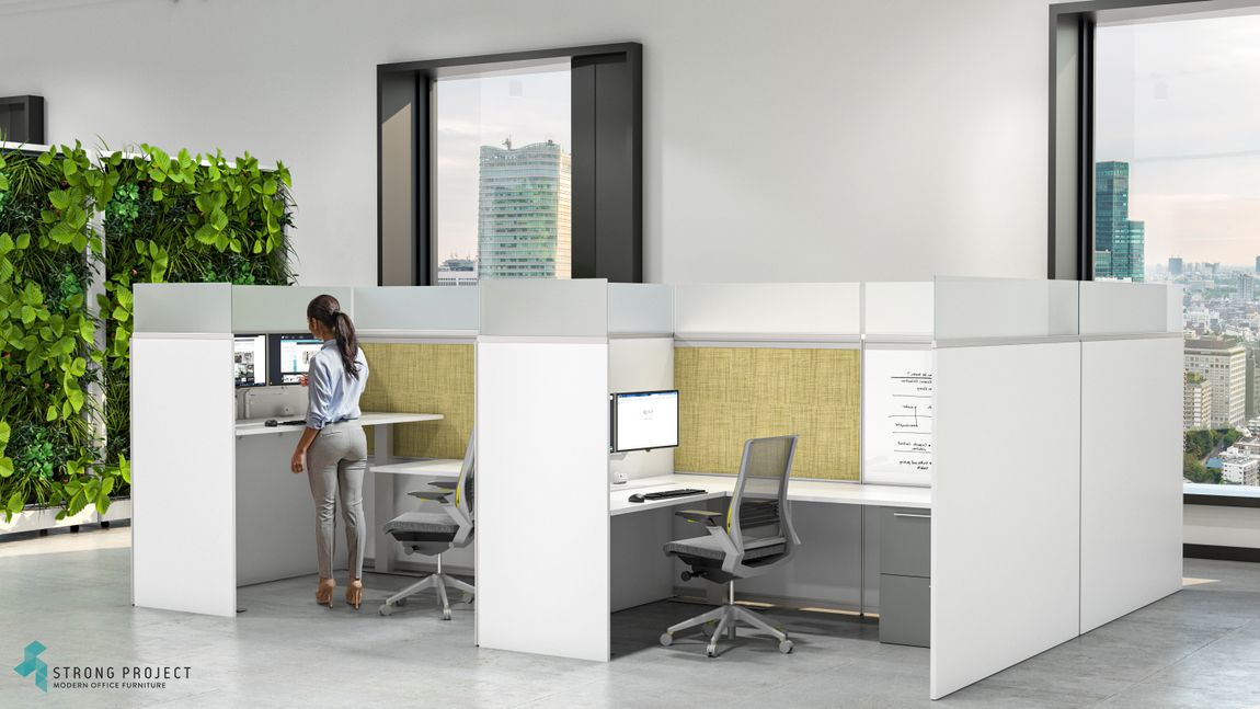 Woman standing at white privacy cubicle